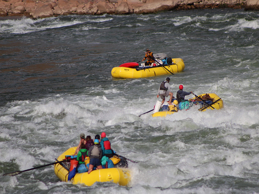 Downstream view of boats running the center of Deubendorff in the Grand Canyon
